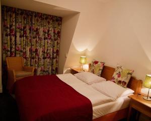 Een bed of bedden in een kamer bij De Strandloper