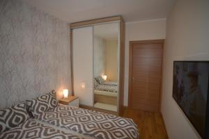 A bed or beds in a room at Apartment Golden Star Spa