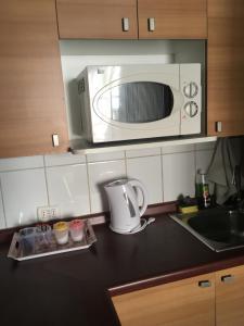 Una cocina o zona de cocina en La cocotte du Chili