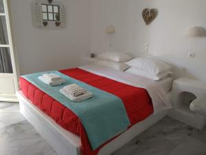 A bed or beds in a room at Nefeli