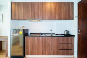 A kitchen or kitchenette at The Nice Condotel by RUS THAI Property