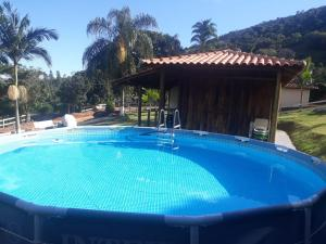 The swimming pool at or near Fazendinha Pompéia