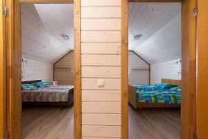 Posteľ alebo postele v izbe v ubytovaní Kafarov