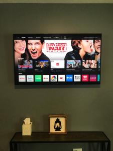 A television and/or entertainment centre at Blue Door on 74