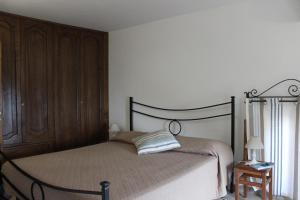 Tempat tidur dalam kamar di La Maiolica Maison