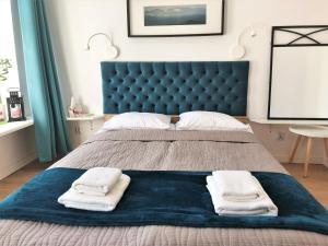 Łóżko lub łóżka w pokoju w obiekcie Apartament na Szczytnej - free PARKING