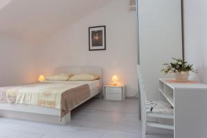 A bed or beds in a room at Villa Anka