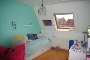A bed or beds in a room at Vakantiehuis Waterakkers Heemskerk