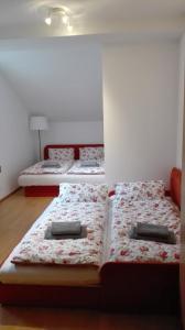 Posteľ alebo postele v izbe v ubytovaní Apartmán NELA Tatran Donovaly
