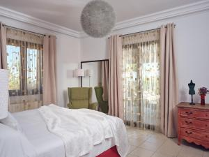 A bed or beds in a room at Palm Luxury Villa