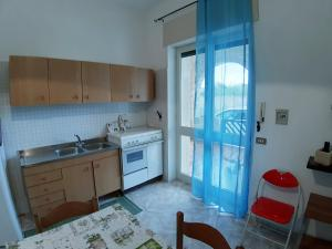 A kitchen or kitchenette at Residence Spiagge Del Salento
