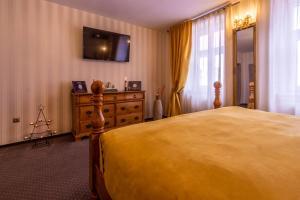 Postel nebo postele na pokoji v ubytování Hermannstadt House 1