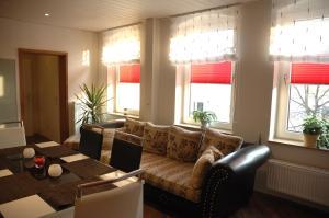 Ein Sitzbereich in der Unterkunft Apartments Stirl