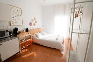 A bed or beds in a room at Bed and Beach Barcelona Guesthouse