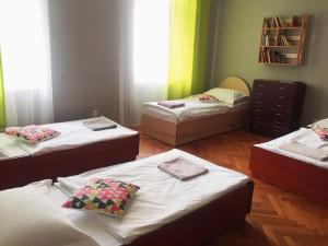 A bed or beds in a room at Shishkin apartments