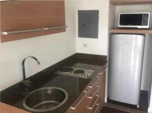 A kitchen or kitchenette at Playa Blanca, Panama