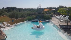 Der Swimmingpool an oder in der Nähe von Piccolo Feudo