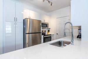 A kitchen or kitchenette at Atlantic Square 2 BR Condos w Pool