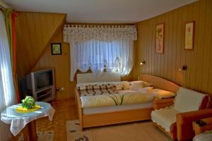 Łóżko lub łóżka w pokoju w obiekcie Apartament Anna