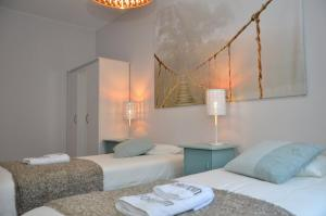 A bed or beds in a room at Forenom Serviced Apartments Oslo S
