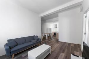 Ein Sitzbereich in der Unterkunft Santa Ana Apartment Madrid Center