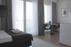 A bed or beds in a room at Forenom Serviced Apartments Rovaniemi Valtakatu