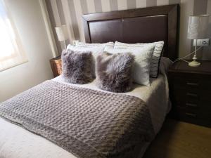 Giường trong phòng chung tại Apartamento AGRELO