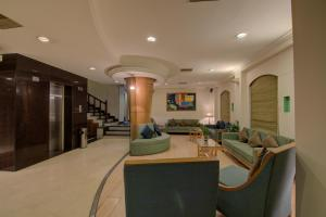 The lobby or reception area at Tristar Service Apartments