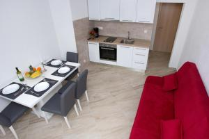A kitchen or kitchenette at Apartments Magdalena
