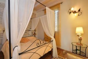 Letto o letti in una camera di Residence Cà di Capri