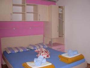 A bed or beds in a room at Apartments Kiro