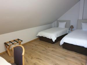 Un ou plusieurs lits dans un hébergement de l'établissement LOFT Tabor