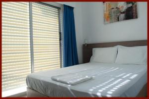 A bed or beds in a room at St. George Rent Rooms