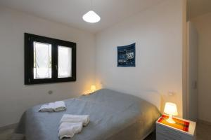 A bed or beds in a room at R&Z Getaway