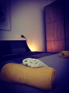 A bed or beds in a room at La Dimora del Principe - Appartamento