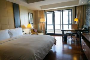 A bed or beds in a room at The Sandalwood Beijing Marriott Executive Apartments