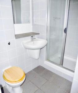 A bathroom at Principality Apartment