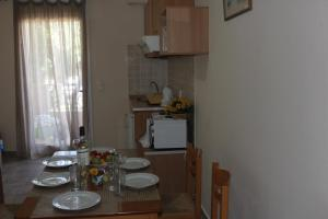 A kitchen or kitchenette at El Greco Apartments