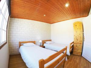 Ein Bett oder Betten in einem Zimmer der Unterkunft Nue Penthouse with Mountains and Sea Views