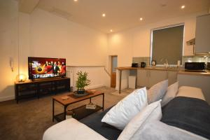 A television and/or entertainment center at F.G. Apartments Winckley Square 1