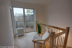 A balcony or terrace at Gasser Apartments - Apartments Karlskirche