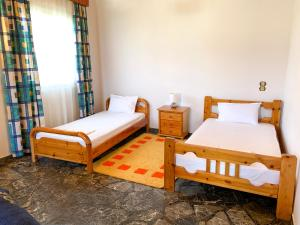 A bed or beds in a room at Magdalini House