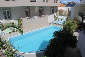 The swimming pool at or near El Greco Apartments