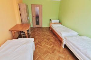 A bed or beds in a room at Vimperk - Šumava