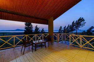 A balcony or terrace at Lake View Holiday Villa Near Sula Wine Yard With 3 BdRms