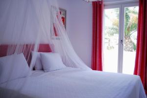 A bed or beds in a room at Villa Bellonia