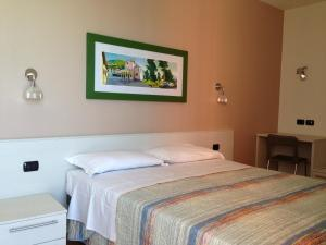 เตียงในห้องที่ Residence CaFelicita