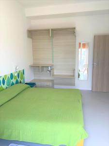Postel nebo postele na pokoji v ubytování Hotel & Residence Al Mare