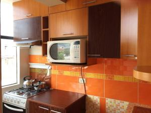 Una cocina o zona de cocina en Ylla Cusco Apartments