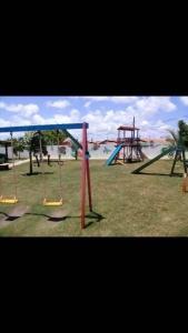 Zona de juegos infantil en Apartamento Aracaju